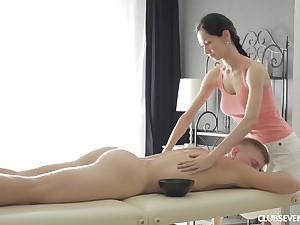 Slender brunette Emma L gives a massage and rides dick