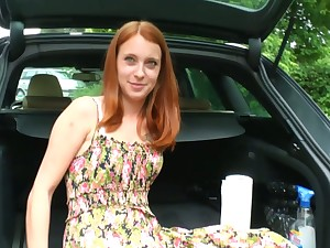 Luscious ginger girlfriend is masturbating her whorish pussy in the trunk