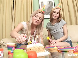 Elly B and another hottie take turns at one's fingertips playing thither a dick