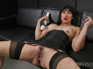 Asian whore sticks large toys in both holes during a voice solo