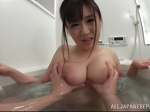 Hot Japanese babe getting titty fucked in the bathtub